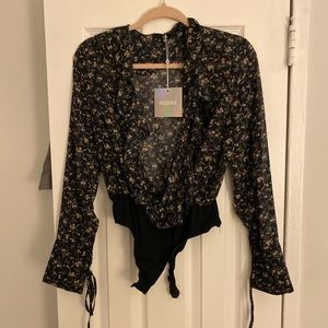 Black floral ruffled body suit
